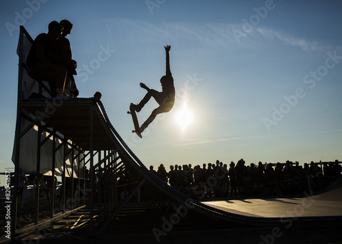 Skateboarder jumping on a ramp
