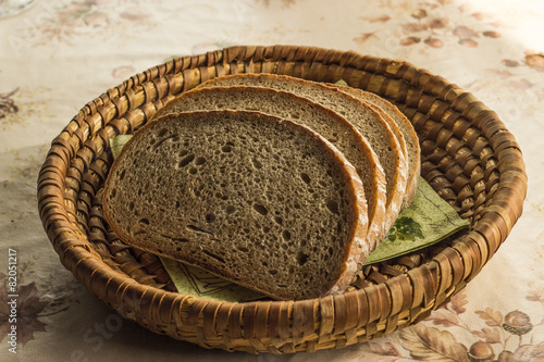 Fotografie, Obraz  Sliced bread in the scuttle