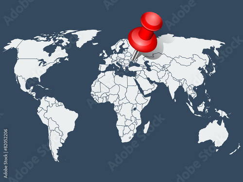 Photo  World map with red push pin