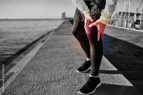 Knee Injury - sports running knee injuries on man. Close up of l