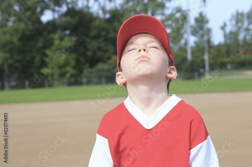 Photo  A children baseball player don't want to play