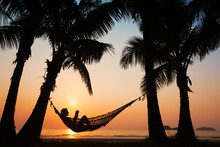 Woman In Hammock On The Beach