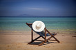 Exotic beach holiday background with white hate on beach chair