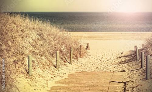 Foto auf Gartenposter Strand Retro toned photo of a beach path.