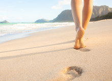Woman Walking On Sandy Beach L...