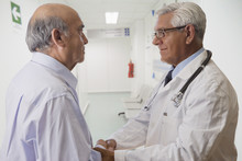 Hispanic Doctor Talking With Patient