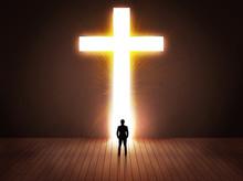 Man Looking At Bright Cross Sign