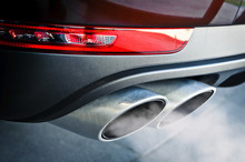 Close Up Of A Car Dual Exhaust...