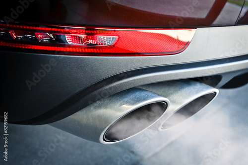 Valokuvatapetti Close up of a car dual exhaust pipe