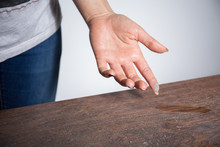 Close-up Of Dust On Woman Finger