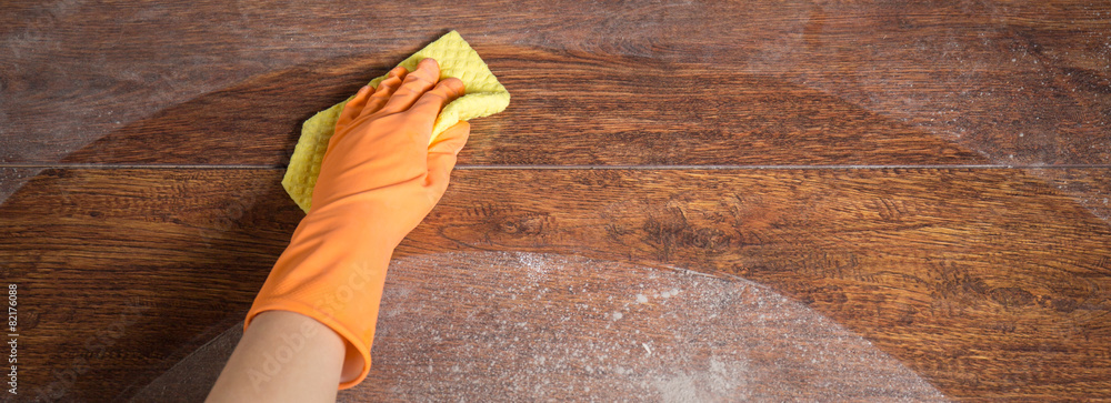 Cleaning soiled parquet in gloves - obrazy, fototapety, plakaty