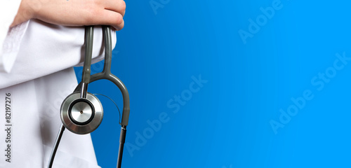 Fotografiet Medical blue background doctor with a stethoscope