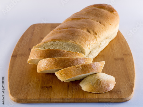 Fotografia, Obraz  French Bread on Wood Cutting Board