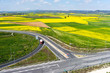 Aerial view of road passing through a rural landscape with bloom