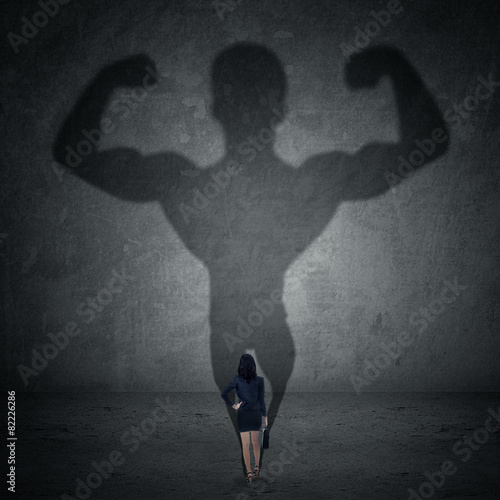 Fotografie, Obraz  Businesswoman and strong shadow 1