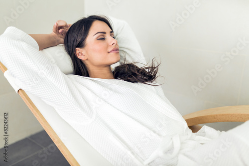 Fotografija Portrait of a beautiful young woman relaxing in a robe