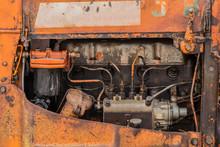 Old Orange Rusty Four Cylinders Engine