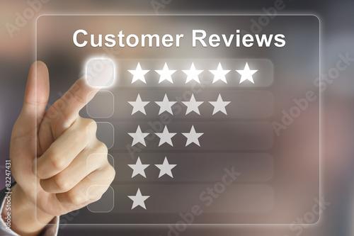 Fotografie, Obraz  business hand pushing customer reviews on virtual screen