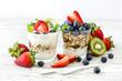 Leinwanddruck Bild - Healthy breakfast with muesli in glass, fresh berries and yogurt