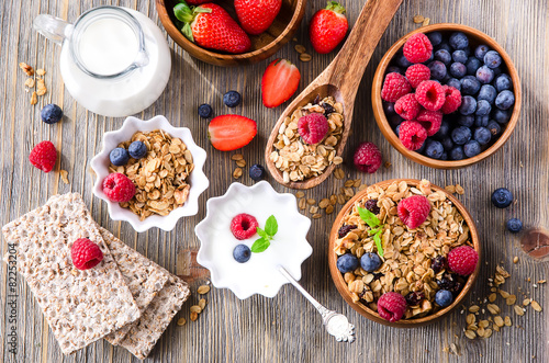 Fresh healthy breakfast with granola and berries, wooden backgro - 82253204