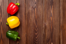 Colorful Bell Peppers On Woode...