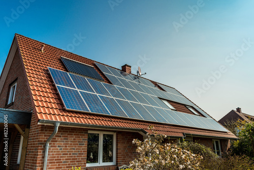 Tablou Canvas Solar panel on a red roof