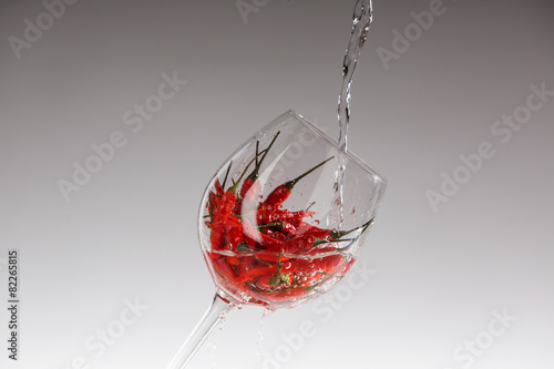 Photo Stands Hot chili peppers Red hot chili pepper in a glass