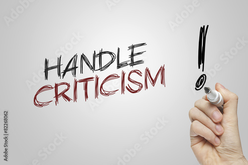 Hand writing handle criticism Fototapeta