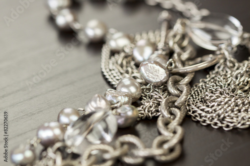 Fotografie, Obraz  Assorted silver costume jewellery with a jumbled pile