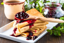Crepes  Folded In Triangles With Currant Jam