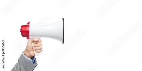 Fotografía  businessman in suit speaking to megaphone