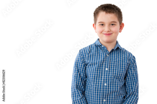 Fotografie, Obraz  10 Year Old Boy with Mischievous Smile on White