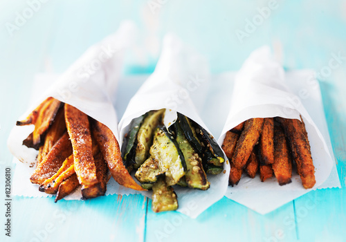 trio of carrot, zucchini, and sweet potato fries shot head on Poster