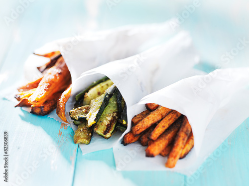 Fotografering  trio of carrot, zucchini, and sweet potato fries