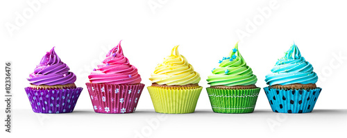 Photo Colorful cupcakes on white