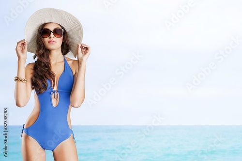 Obraz Swimsuit. Portrait of a young girl in fashionable swimsuit - fototapety do salonu