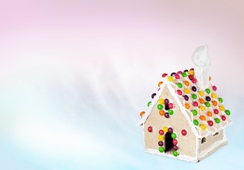 Gingerbread. Homemade gingerbread house on brown background