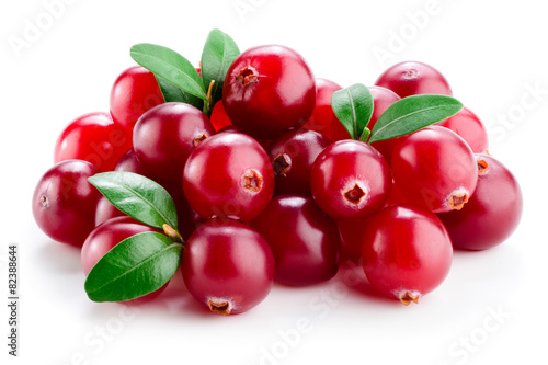 Fotografia  Cranberry with leaves isolated on white.