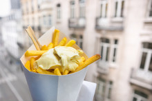 Belgian Fries With Mayonnaise On Blurred Street Background