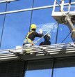worker washing office windows