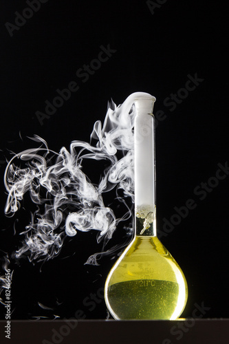 Chemical reaction in volumetric flask glass in labolatory