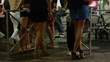 Slow motion shot of women smoking cigarettes at night / Nice, France
