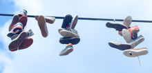 Sport Shoes Are Hanging Over T...