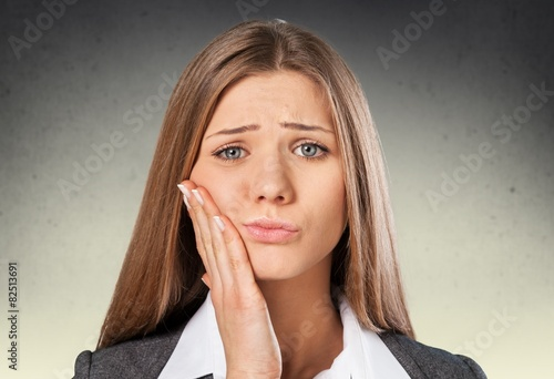 Abscess. Closeup portrait young woman with sensitive tooth ache Tablou Canvas