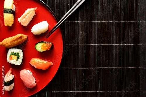Mixed sushi platter with chopsticks