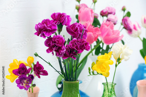 Different Beautiful Flowers In Vases Close Up Buy This Stock Photo