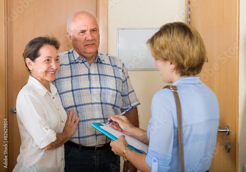 Fotografia, Obraz Senior couple with social worker at home