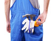 Man in coveralls with tools in his pocket isolated on white