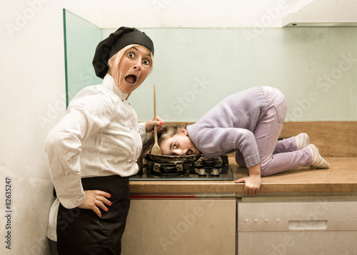 Fotografie, Tablou  chef cooking child on fire