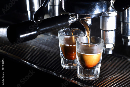 Professional espresso machine brewing a coffee Poster